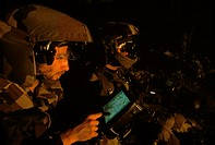 Soldiers using global positioning system (GPS) equipment. GPS relies on a network of 24 US military satellites. By detecting signals broadcast from th...