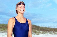 Woman with Swimsuit and Goggles on Beach Smiling
