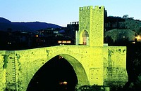 Medieval bridge of Besalu built in XI century. Girona province. Spain
