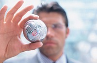 Businessman looking at silver ball