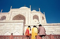 Young muslims sitting on balustrade. Taj Mahal. Agra. Uttar Pradesh. India