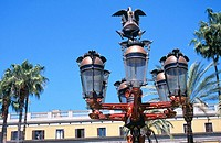 Street lamps at Plaza Real, whose design was inspired by Gaudí's models (c. 1878). Barcelona. Spain