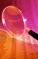 Magnifying glass on financial page