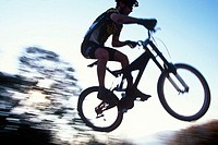 Mountain biker gets big air on a jump