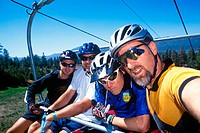 Mountain bikers riding the mountain ski  lift up the hill