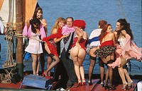 Tinto Brass and the female cast of the film ´Trasgredire´, Mostra del Cinema, Venice, 1999