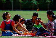 Children having a  picnic in a park.
