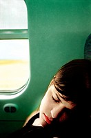 Woman sleeping in train