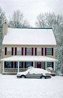 House and car covered with snow, snowy woods behind, Monroe County, Indiana, USA