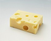 Emmental cheese (rectangular piece) on light background