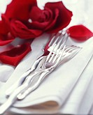 Cutlery on table with white napkins & rose petals (3)