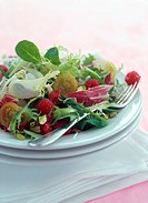 Mixed salad leaves with tomatoes and raspberries