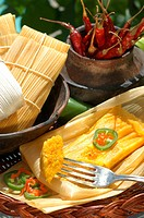 Tamales (maize porridge steamed in maize husk, 2)