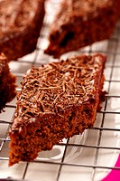 Brownies with grated chocolate on cake rack