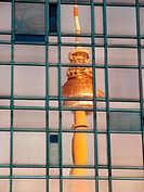 Television tower reflected on glass facade. Berlin. Germany