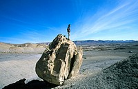 Man standing on rock, Glen Canyon Area, Utah, USA (thumbnail)