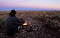 Camp with campfire in wide open space, Crooked Creek Range, Malheur County, Eastern Oregon, USA