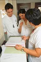 STUDENT NURSE W. PATIENT RECORD<BR>Pitié Salpêtrière Hospital in Paris, France.