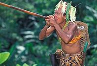 An Orang Asli man with a blowpipe, Malaysia