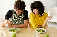 Couple having meal at home