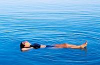 Woman floating, Dead Sea. Israel