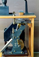Detail. John Milne (1851-1913) designed the first horizontal pendulum seismograph in 1895. This example, made by R W Munro, is number 24 in the series...