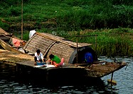 Vietnam, people on dock next to houseboat
