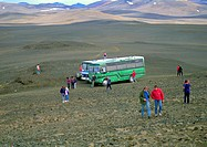Iceland, people near bus in mountainous region
