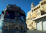 Syria, front of blue bus and ancient building