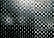 Metal sheet perforated with holes, close-up, full frame