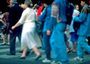 Crowd walking on sidewalk, blurred