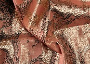 Folds in pink and silver fabric, close-up, full frame