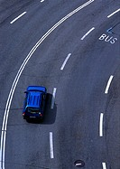 Blue car on highway, birdseye view
