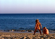 Nude children on beach