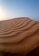 Tunisia, Sahara, rippled sand dune against sky