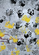 Yellow, black, gray hand print on wall