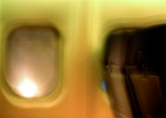 Window in airplane, blurred