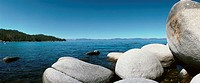Malaysia, rocks in sea, coast in background, panoramic view
