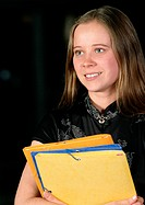 Young woman holding folders, portrait