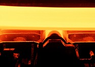 Molten metal in rolling mill, close-up