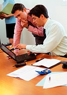 Two businessmen looking at laptop computer