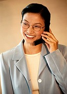 Businesswoman using telephone, portrait