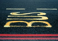 'Bus' text painted on asphalt, close-up