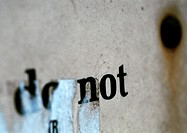 'do not' text printed on paper and partially obscured
