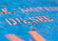 'Diesel' text stenciled on rusty surface, close-up
