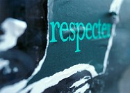 'To respect' printed in French on torn poster, close-up