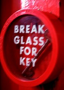 Key behind glass with 'break glass for key' text