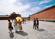 China, Beijing, people in Forbidden City courtyard