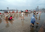 China, Shanghai, The Bund, people walking in rain