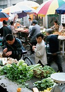 China, Beijing, people in open-air market, blurred